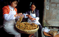 Women preserving bamboo shoots