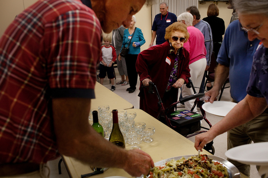 Laguna Woods, California, November 3, 2010 - Members of Village Cannabis enjoy food and drinks during one of their monthly meetings. Village Cannabis Club is a sister organization to Laguna Woods Village for Medical Cannabis, a collective of about 100 members that operates as a dispensary for medical marijuana in the nearby senior community of Laguna Woods Village and its environs. The club serves as a organization that holds regular meetings to help educate the community to the benefits of marijuana. Tonight they discussed the outcome of Proposition 19, which would have made recreational marijuana use legal. .
