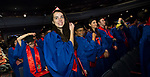 Students flip their tassels Saturday, June 10, 2017, during the DePaul University School of Music and The Theatre School commencement ceremony at the Rosemont Theatre in Rosemont, IL. (DePaul University/Jeff Carrion)
