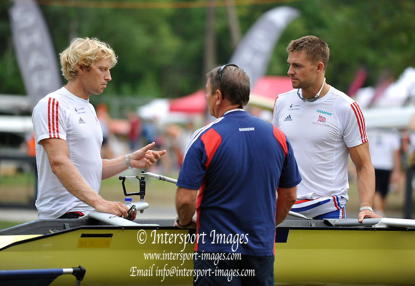 Bled, SLOVENIA.  General views, Boat house area, GBR M2-, Left Andy TWIGGS HODGE, centre [coach]  Jurgan GROBLER and Peter REED.  2011 FISA World Rowing Championships, Lake Bled. Saturday  27/08/2011   [Mandatory Credit; Peter Spurrier/ Intersport Images]