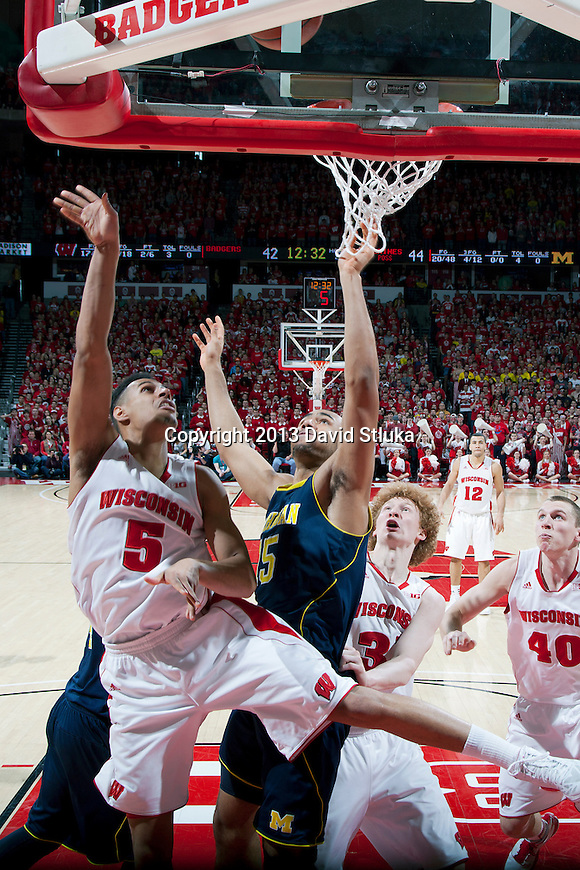 Wisconsin Badgers forward Ryan Evans (5) shoots the ball during a Big Ten Conference NCAA college basketball game against the Michigan Wolverines Saturday, February 9, 2013, in Madison, Wis. The Badgers won 65-62 (OT). (Photo by David Stluka)