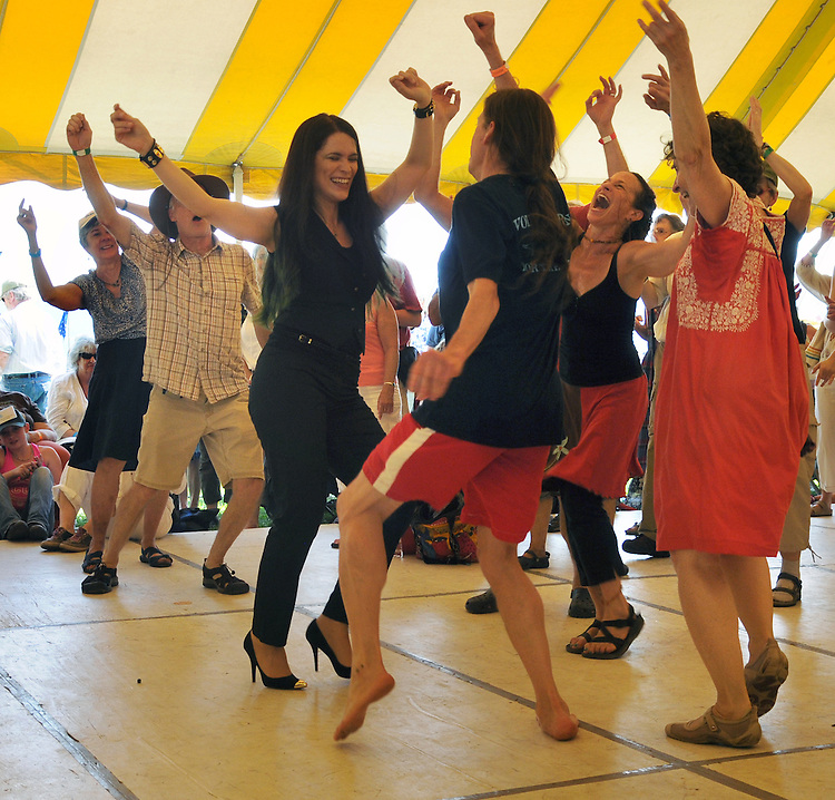 Cristina Pato, dancing along with members of the audience, on the Dance Stage, on the first day of the Clearwater's Great Hudson River Revival Festival 2013, held at Croton Point Park, in Croton-on-Hudson, NY, June 15, 2013. Photo by Jim Peppler. Copyright Jim Peppler 2013 all rights reserved.