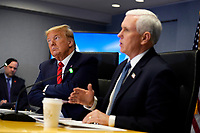 United States President Donald J. Trump, second from right, listens as US Vice President Mike Pence speaks during a teleconference with governors at the Federal Emergency Management Agency headquarters, Thursday, March 19, 2020, in Washington, DC.<br /> Credit: Evan Vucci / Pool via CNP/AdMedia