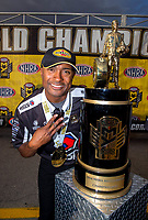 Oct 30, 2016; Las Vegas, NV, USA; NHRA top fuel driver Antron Brown poses for a photo with the championship trophy as he celebrates after clinching championship during the Toyota Nationals at The Strip at Las Vegas Motor Speedway. Mandatory Credit: Mark J. Rebilas-USA TODAY Sports