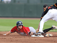 Norfolk Tides first baseman Brandon Snyder (29) slides around the tag of Matt Tolbert (4) but is called out on the play during a game vs. the Rochester Red Wings at Frontier Field in Rochester, New York;  May 31, 2010.  Norfolk defeated Rochester by the score of 2-1.  Photo By Mike Janes/Four Seam Images