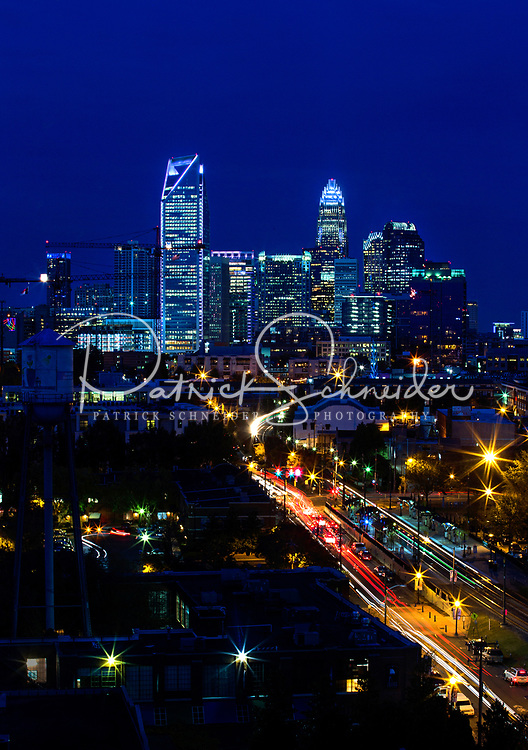 Skyline photography of the Charlotte NC downtown skyline. Photo, taken from the south side of Charlotte, is part on a regularly updated collection of Charlotte skyline imagery. Image shows the Duke Energy headquarters tower (far left) and the Bank of America tower (center) as well as other key structures in the Charlotte NC skyline.<br /> <br /> Charlotte Photographer - PatrickSchneiderPhoto.com