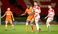 Blackpool's Armand Gnanduillet and Doncaster Rovers' Andrew Butler<br /> <br /> Photographer Rachel Holborn/CameraSport<br /> <br /> The EFL Sky Bet League One - Doncaster Rovers v Blackpool - Tuesday 27th November 2018 - Keepmoat Stadium - Doncaster<br /> <br /> World Copyright &copy; 2018 CameraSport. All rights reserved. 43 Linden Ave. Countesthorpe. Leicester. England. LE8 5PG - Tel: +44 (0) 116 277 4147 - admin@camerasport.com - www.camerasport.com