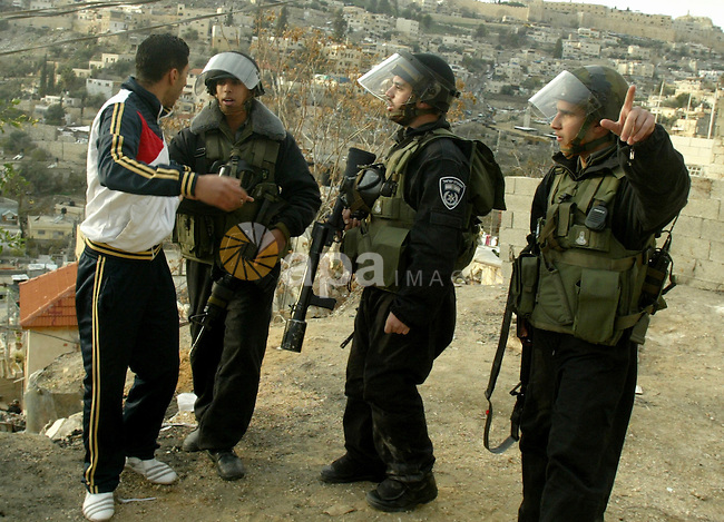 Israeli policemen stand guard during clashes with Palestinian youths in the Arab east Jerusalem neighbourhood of Silwan against Jewish settlement activity in the Palestinian districts of the holy city on Jan. 16, 2011. Photo by Mahfouz Abu Turk