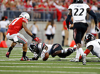 Cincinnati Bearcats cornerback Leviticus Payne (9) falls on a fumble in front of Ohio State Buckeyes running back Jalin Marshall (17) during the second quarter of the NCAA football game at Ohio Stadium in Columbus on Sept. 27, 2014. (Adam Cairns / The Columbus Dispatch)