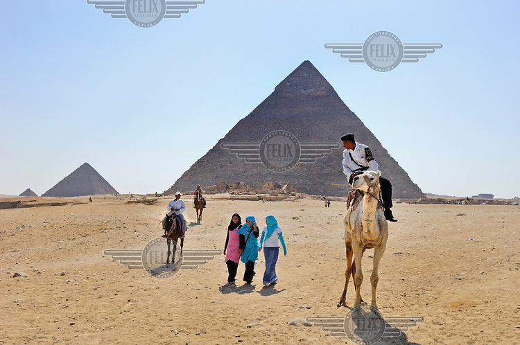 Young women visiting the pyramids drawing the attention of touts and policeman alike