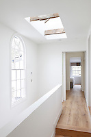 Contemporary timber flooring adds to the light bright feeling of the upstairs landing