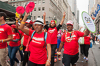NBCUniversal employees and supporters in the annual Lesbian, Gay, Bisexual and Transgender Pride Parade on Fifth Avenue in New York on Sunday, June 28, 2015. The parade was particularly boisterous due to the recent Supreme Court decision on same-sex marriage. The parade is the largest gay pride parade in the world.(© Richard B. Levine)