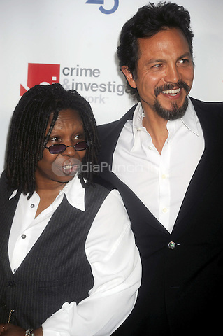 Whoopi Goldberg and Benjamin Bratt at the 2009 A&E New York Upfront at The Rainbow Room in New York City. May 14, 2009. Credit: Dennis Van Tine/MediaPunch