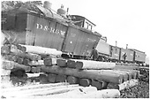 Engine has telescoped box car 3385.<br /> D&amp;RGW  Lumberton, NM  7/1923
