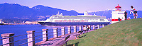 Alaska Bound Cruise Ship departing Port of Vancouver Harbour, past Historic Brockton Point Lighthouse and Stanley Park Seawall, BC, British Columbia, Canada - North Vancouver and Grouse Mountain beyond, Panoramic View
