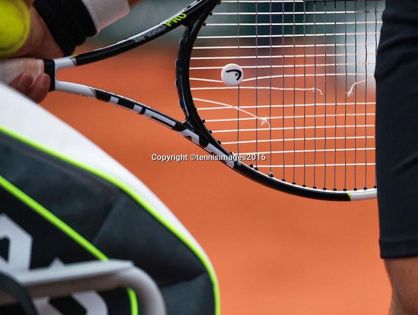 Paris, France, 31 June, 2016, Tennis, Roland Garros, Tennis racket with broken string<br /> Photo: Henk Koster/tennisimages.com