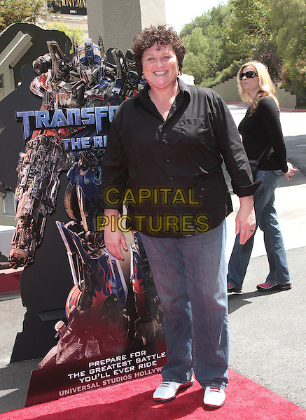 Dot Marie Jones.The World Premiere of Universal Studios Hollywood's 'Transformers: The Ride-3D' held at Universal Studios, Universal City, California, USA..May 24th, 2012.full length black shirt jeans denim.CAP/ADM/SLP/JO.©James Orken/Starlitepics/AdMedia/Capital Pictures.