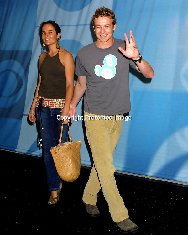 ©2003 KATHY HUTCHINS  / HUTCHINS PHOTO AGENCY.CBS Television Critics Tour Summer 2003 Party.Hollywood & Highland .Lucky Strike Bowling Alley.Hollywood, CA.July 20, 2003..SIMON BAKER AND WIFE REBECCA