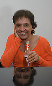22/05/2006 Barbican Hall, London, England. Arnaldo Baptista of Brazilian legends Mutantes; reunion gig after 33 years. In the dressing room after the gig with a bottle of beer.