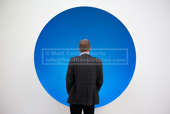 09/10/2012. LONDON, UK.  A gallery visitor views Anish Kapoor's sculpture 'Inner Beauty' (2012) at a press view ahead of his new exhibition at the Lisson Gallery in London today (09/12/12) . The exhibition, the first since the artists solo exhibition at the Royal Academy of the Arts in 2009, features new works by Kapoor and runs from the 10th of October to the 10th of November 2012. Photo credit: Matt Cetti-Roberts