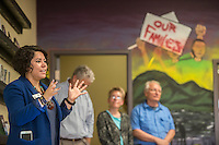 NWA Democrat-Gazette/ANTHONY REYES &bull; @NWATONYR<br /> Mireya Reith, excutive director for the Arkansas United Community Coalition, gives a few remarks Tuesday, Aug. 18, 2015 at a block party and ribbon cutting for the Immigrant Resource Center in Springdale. The Center is the first of five planned for the state. It is a cooperation between Arkansas United Community Coalition and Catholic Charities Immigration Services of Northwest Arkansas and will provide area immigrants with immigration navigation services, leadership development opportunities, and civic integration support. The event introduced the public to the services provided by the center and several other organizations were on hand to distribute information about their organizations.