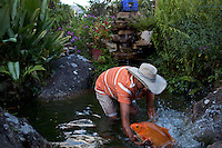 Jan. 01, 2012 - Vilavicencio, Colombia. A man attempts to catch a fish in his pond. © Nicolas Axelrod / Ruom