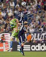 New England Revolution defender Darrius Barnes (25) succeeds in battle for head ball with Seattle Sounders FC forward Nate Jaqua (21) and New England Revolution midfielder Pat Phelan (28). The New England Revolution defeated the Seattle Sounders FC, 3-1, at Gillette Stadium on September 4, 2010.