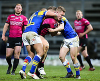 Hull FC 's Chris Green is tackled by Leeds Rhinos' Jamie Jones-Buchanan and Matt Parcell<br /> <br /> Photographer Alex Dodd/CameraSport<br /> <br /> Betfred Super League Round 5 - Leeds Rhinos v Hull FC - Thursday 8th March 2018 - Headingley Carnegie Stadium - Leeds<br /> <br /> World Copyright &copy; 2018 CameraSport. All rights reserved. 43 Linden Ave. Countesthorpe. Leicester. England. LE8 5PG - Tel: +44 (0) 116 277 4147 - admin@camerasport.com - www.camerasport.com