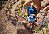 August 19, 2017 - Colorado Springs, Colorado, U.S. -  Alamosa, Colorado's mountain running legend, Simon Gutierrez, navigates the final boulder field near the summit of the 62nd running of the Pikes Peak Ascent.  The Ascent is a full half-marathon gaining over 7800 feet in elevation to reach the summit at 14,115 feet.  Mountain runners from around the world converge on Pikes Peak for two days of racing on America's Mountain in Colorado Springs, Colorado.