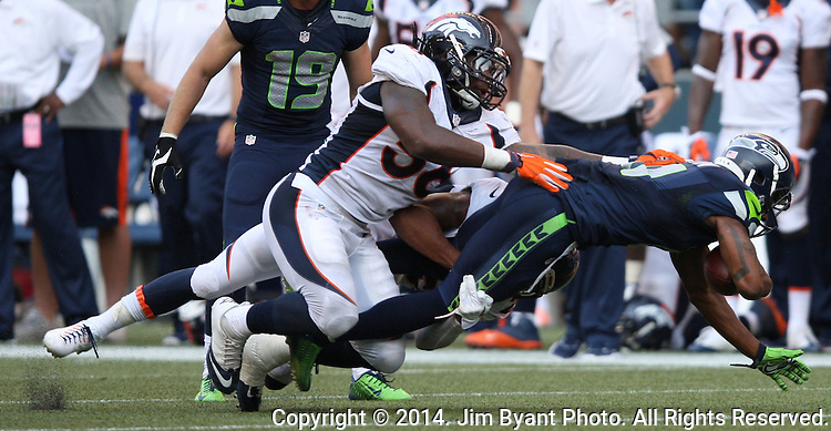 Seattle Seahawks  Denver Broncos in the quarter at CenturyLink Field in Seattle, Washington on September 21, 2014. The Seahawks won 26-20 in overtime.    UPI/Jim BryantSeattle Seahawks  Denver Broncos in the quarter at CenturyLink Field in Seattle, Washington on September 21, 2014. The Seahawks won 26-20 in overtime.    ©2014. Jim Bryant Photo. All rights Reserved.
