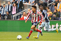 Carlos Alvarez (20) midfield Chivas USA in action goes past Peterson Joseph (19) midfield Sporting KC ..Sporting Kansas City defeated Chivas USA 4-0 at Sporting Park, Kansas City, Kansas.
