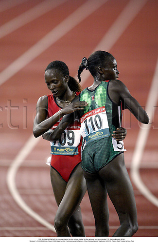 709. SUSAN CHEPKEMEI is congratulated on her silver medal by the winner and team mate 710. Salina Kosgei (KEN),.Women's 10,000 Metres Final, 2002 Manchester Commonwealth Games, City of Manchester Stadium, 020730. Photo: Neil Tingle/Action Plus...athletics athletes athlete.runner runners.track event distance sportsmanship.congratulations congratulating congratulate teammate team mates.woman......................................