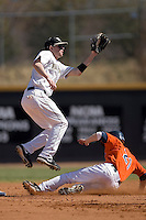 Dustin Hood #21 of the Wake Forest Demon Deacons goes up high for a throw as Dan Grovatt #21 of the Virginia Cavaliers steals second base at Wake Forest Baseball Park March 8, 2009 in Winston-Salem, NC. (Photo by Brian Westerholt / Four Seam Images)