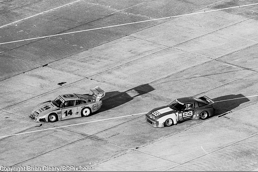 #14 Porsche 935 of  Bob Wollek, John Graham, Hugo Gralia, Preston Henn, and Al Holbert, 6th place, and #93 Mazda RX7 of Don Marsh, Ron Pawley, Kelly Mars, and  Whitney Ganz, 19th place, aerial view from the Goodyear blimp, 12 Hours of Sebring, IMSA Camel GT race, Sebring International Raceway, Sebring, Florida, March 24, 1984.  (Photo by Brian Cleary/www.bcpix.com)