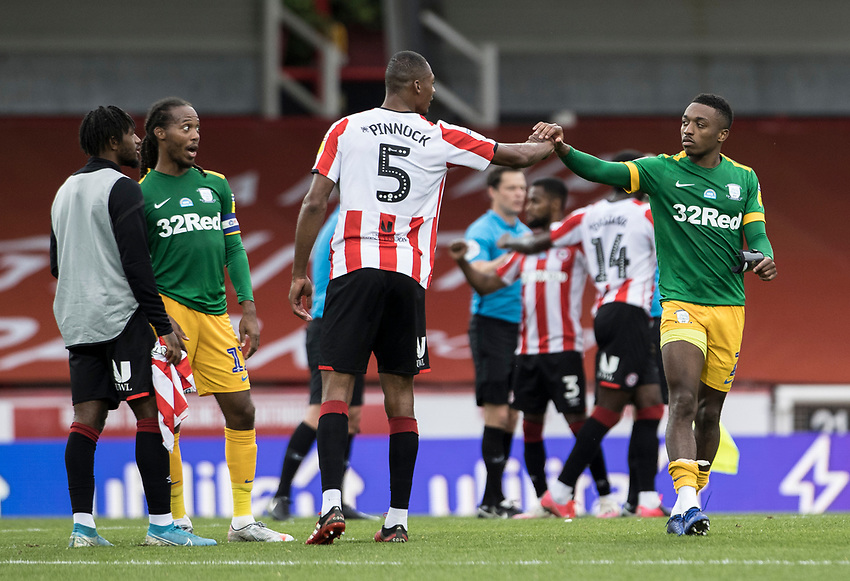 Preston North End's Darnell Fisher bumps fists with Brentford's Ethan Pinnock at the end of the match<br /> <br /> Photographer Andrew Kearns/CameraSport<br /> <br /> The EFL Sky Bet Championship - Brentford v Preston North End - Wednesday 15th July 2020 - Griffin Park - Brentford <br /> <br /> World Copyright © 2020 CameraSport. All rights reserved. 43 Linden Ave. Countesthorpe. Leicester. England. LE8 5PG - Tel: +44 (0) 116 277 4147 - admin@camerasport.com - www.camerasport.com