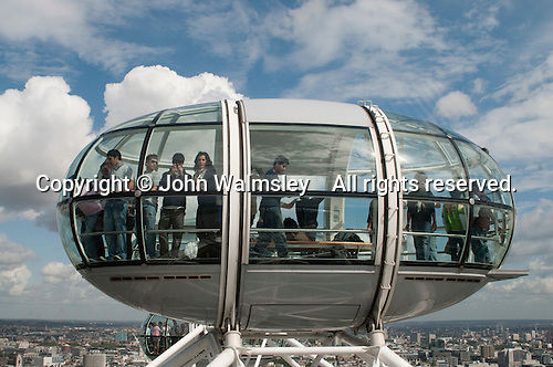 From the top, the capsules can see 40 kilometres.  The London Eye on the Southbank of the River Thames in London.  Stands 135 metres tall and carries 3.5 million visitors each year.  Conceived and designed by David Marks & Julia Barfield, it took 7 years to design & build and involved products made by specialists in 5 countries.   It was originally sponsored by British Airways, who ran it from 2000 until 2005, when it was known as the Millenium Wheel.
