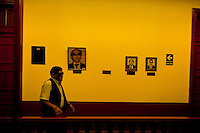 A blind man walks along the pictures of the club founders hung on the wall of Unión Nacional de Ciegos del Perú, a social club for the visually impaired in Lima, Peru, 3 April 2013. Unión Nacional de Ciegos del Perú, one of the first societies for disabled in Latin America, was established in 1931 to provide a daily service for blind and partially sighted people from the capital city. The range of activities includes reading books in a large Braille library, playing chess or using a computer adapted for visually impaired individuals. As the majority of the blind does not have a regular job, the UNCP club offers them an opportunity to learn and lately, to provide massages to the club visitors and thus generate some income.