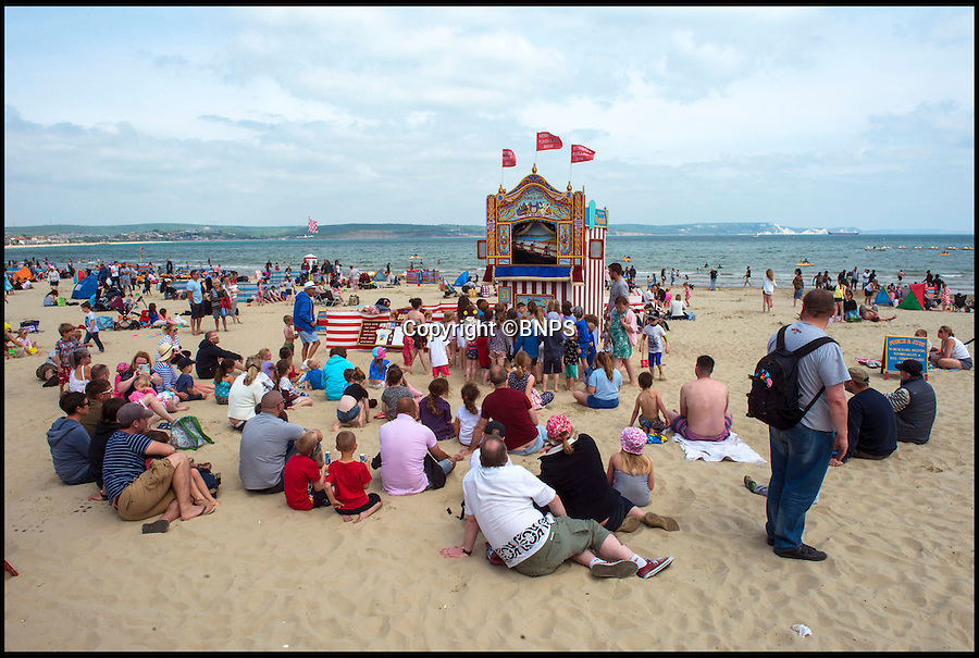 BNPS.co.uk (01202 558833)<br /> Pic: PhilYeomans/BNPS<br /> <br /> That's not the way to do it...130 year Punch & Judy tradition could be knocked out by unruly audiences.<br /> <br /> Weymouth Punch & Judy man Mark Poulton is threatening to end the Victorian seaside tradition because of 'rowdy and uncontrolled' children in the audience.