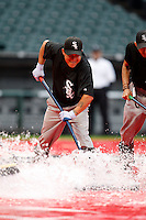 August 7, 2009:  Workers remove water from the field before a game for the Chicago White Sox vs. the Cleveland Indians at U.S. Cellular Field in Chicago, IL.  The Indians defeated the White Sox 6-2.  Photo By Mike Janes/Four Seam Images