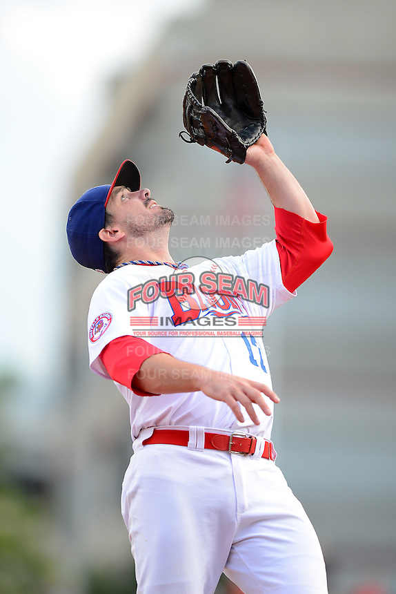 Buffalo Bisons third baseman Andy LaRoche (17) catches a pop up during a game against the Pawtucket Red Sox on August 4, 2013 at Coca-Cola Field in Buffalo, New York.  Pawtucket defeated Buffalo 8-1.  (Mike Janes/Four Seam Images)
