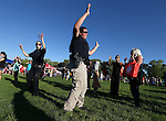 Washoe Tribal Officers Savannah Gray, left, and Ruby Fox do the Hokey Pokey with the crowd during the 14th annual National Night Out in Carson City, Nev., on Tuesday, Aug. 2, 2016. <br />