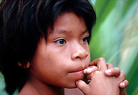 Head shot of a young boy of the Amazon tribes. Peru.