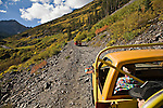 Jeeps travel on dirt roads through Upper Camp Bird outside of Ouray, Colorado