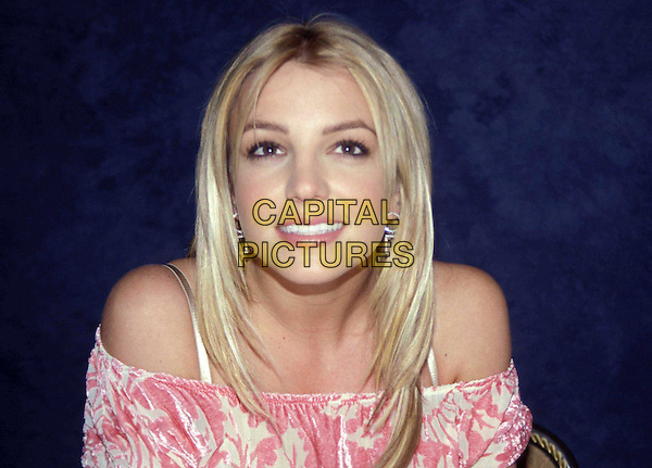 BRITNEY SPEARS..Ref: 11473..pink and white top, off the shoulder, headshot, portrait, smiling, earrings, smiling..www.capitalpictures.com..sales@capitalpictures.com..©Capital Picture
