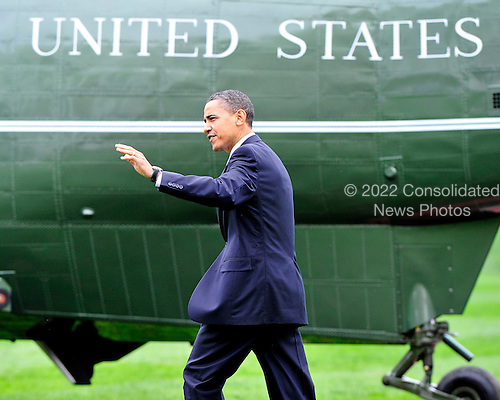 Washington, D.C. - March 25, 2010 -- United States President Barack Obama waves to guests as he walks across the South Lawn of the White House to board Marine 1 for Iowa City, Iowa where he will deliver remarks on the benefits of his health care reform bill which was signed earlier in the week on Thursday, March 25, 2010..Credit: Ron Sachs / Pool via CNP