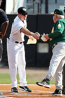 UCF Knights coach Ryan Klosterman #7 greets Tony Rossi #40 before a game against the Siena Saints at the UCF Baseball Complex on March 3, 2012 in Orlando, Florida.  UCF defeated Siena 6-4.  (Mike Janes/Four Seam Images)