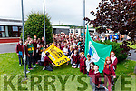 Aine McKenna helps raise the Junior Entrepreneur and the the fourth Green Flag at Duagh NS on Friday afternoon.