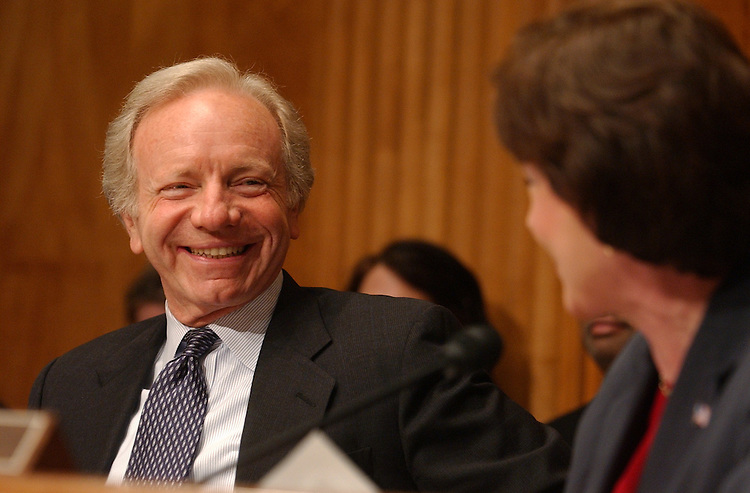 Sen. Joe Lieberman, D-Conn., shares a laugh with Sen. Sue Collins, R-Me.,  after she welcomed him back from his Presidential nomination run before a Senate Government Affairs Committee, Full Committee hearing on FY2005 budget for Homeland Security Department with witness, Director of Homeland Security Tom Ridge.