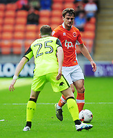 Blackpool's Andy Taylor under pressure from Exeter City's Jake Taylor<br /> <br /> Photographer Kevin Barnes/CameraSport<br /> <br /> Football - The EFL Sky Bet League Two - Blackpool v Exeter City - Saturday 6th August 2016 - Bloomfield Road - Blackpool<br /> <br /> World Copyright © 2016 CameraSport. All rights reserved. 43 Linden Ave. Countesthorpe. Leicester. England. LE8 5PG - Tel: +44 (0) 116 277 4147 - admin@camerasport.com - www.camerasport.com
