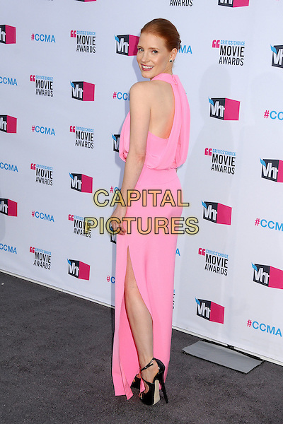 Jessica Chastain.17th Annual Critics Choice Movie Awards - Arrivals held at the Hollywood Palladium,  Los Angeles, California, USA, 12th January 2012..arrivals full length pink long maxi dress  sleeveless  smiling back rear over shoulder .CAP/ADM/BP.©Byron Purvis/AdMedia/Capital Pictures.